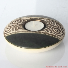 Ceramic candle holder with brown flecked glaze