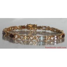 Tennis bracelet multi stone multi color. Sterling silver tennis bracelet gold plated.