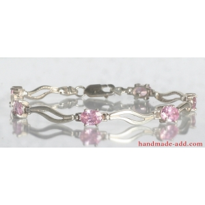 Tennis bracelet pink CZ. Sterling silver tennis bracelet with Pink Cubic Zirconia.