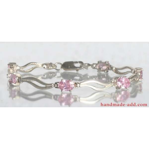 Tennis bracelet pink CZ. Sterling silver tennis bracelet with Pink Cubic Zirconia.