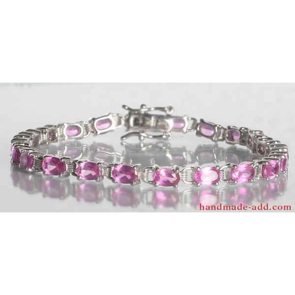 Tennis bracelet pink sapphire. Sterling silver tennis bracelet with lab created pink sapphire.