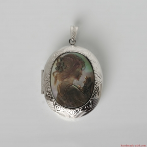 Carved mother-of-pearl cameo locket pendant with child motif